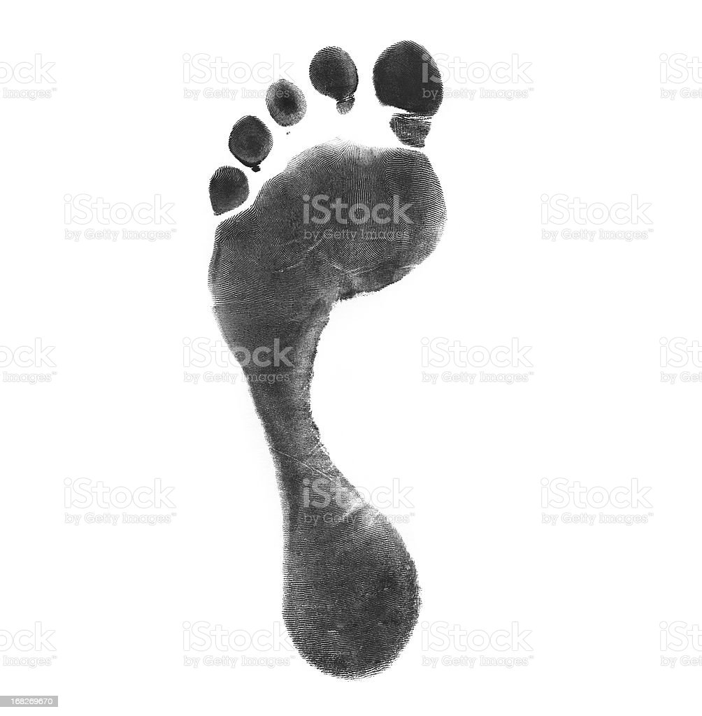 Left foot using black ink for a carbon footprint stock photo