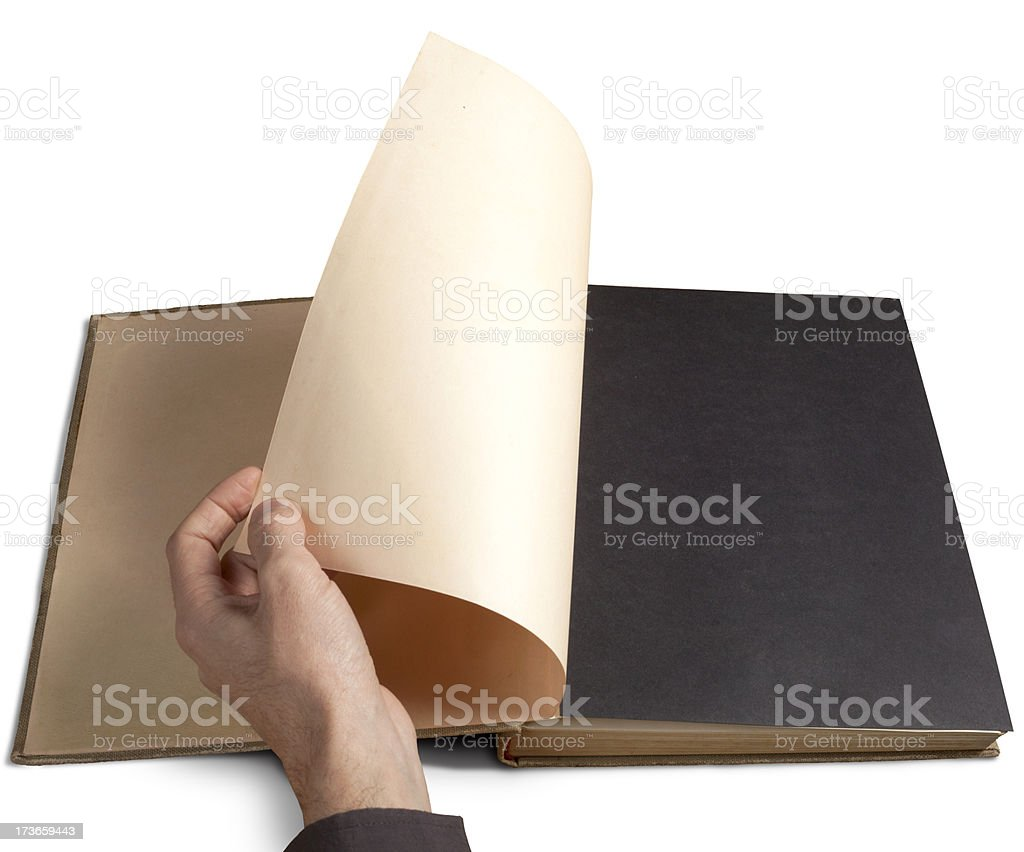 Left hand flicking the first page of a book stock photo