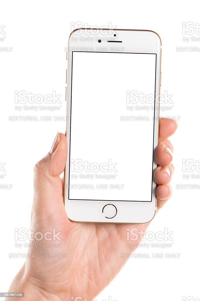 Left hand holding gold iPhone 6 with white screen stock photo