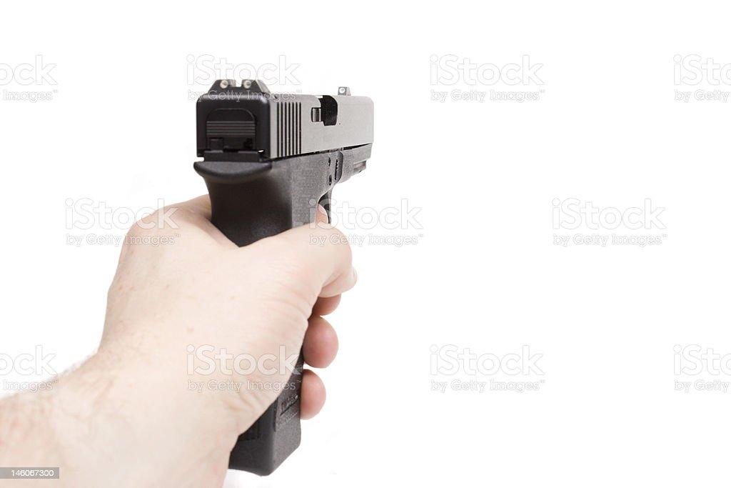 left hand holding handgun isolated on white royalty-free stock photo
