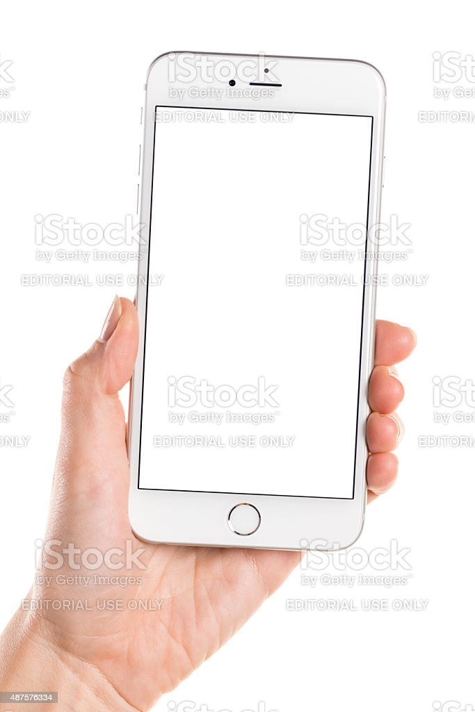 Left hand holding silver iPhone 6 Plus with white screen stock photo
