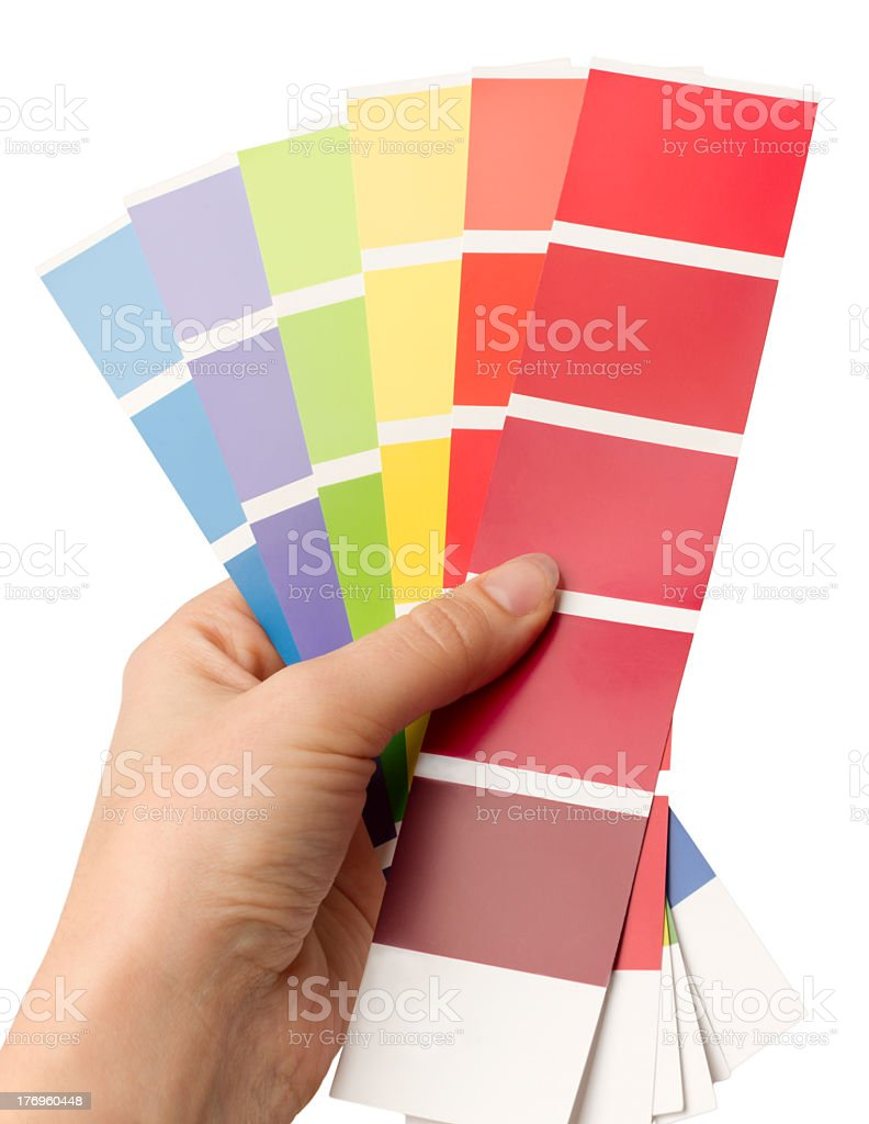Left hand holding six color charts in fan shape stock photo
