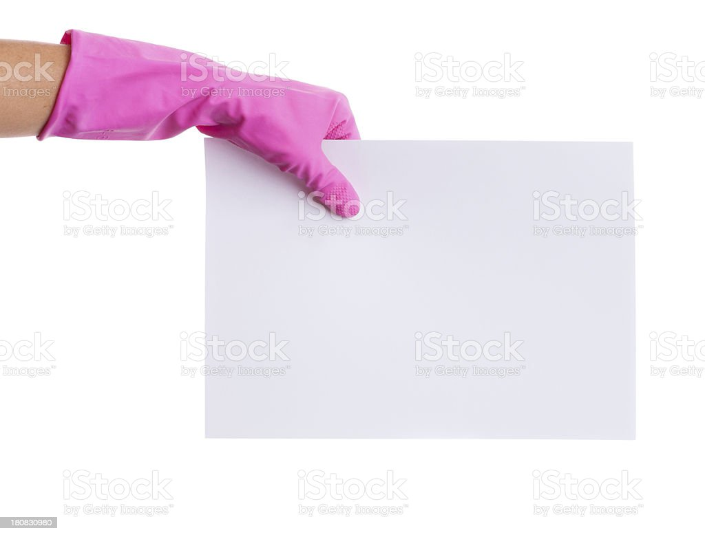 Left hand in pink glove holding blank A4 paper royalty-free stock photo