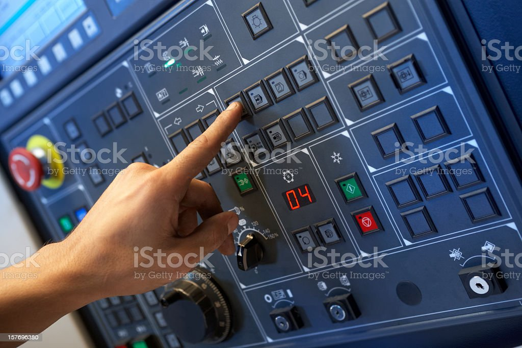 Left hand pressing buttons on a control panel stock photo
