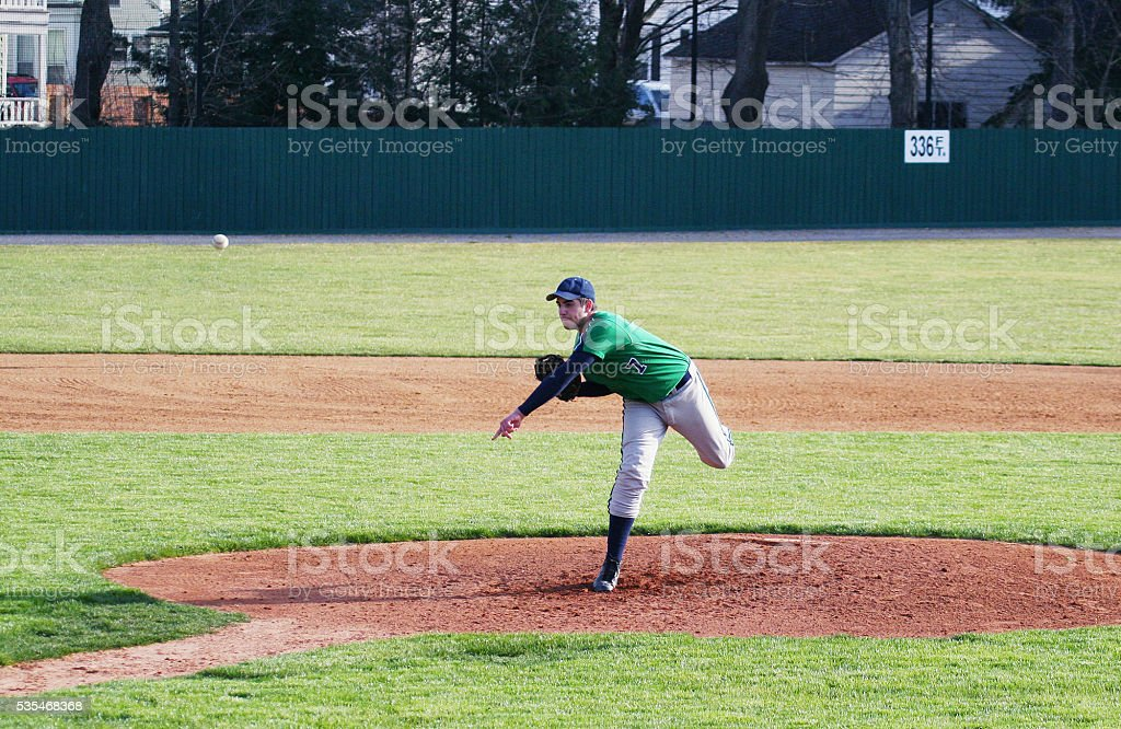 Left Handed High School Baseball Pitcher Throwing Pitch stock photo