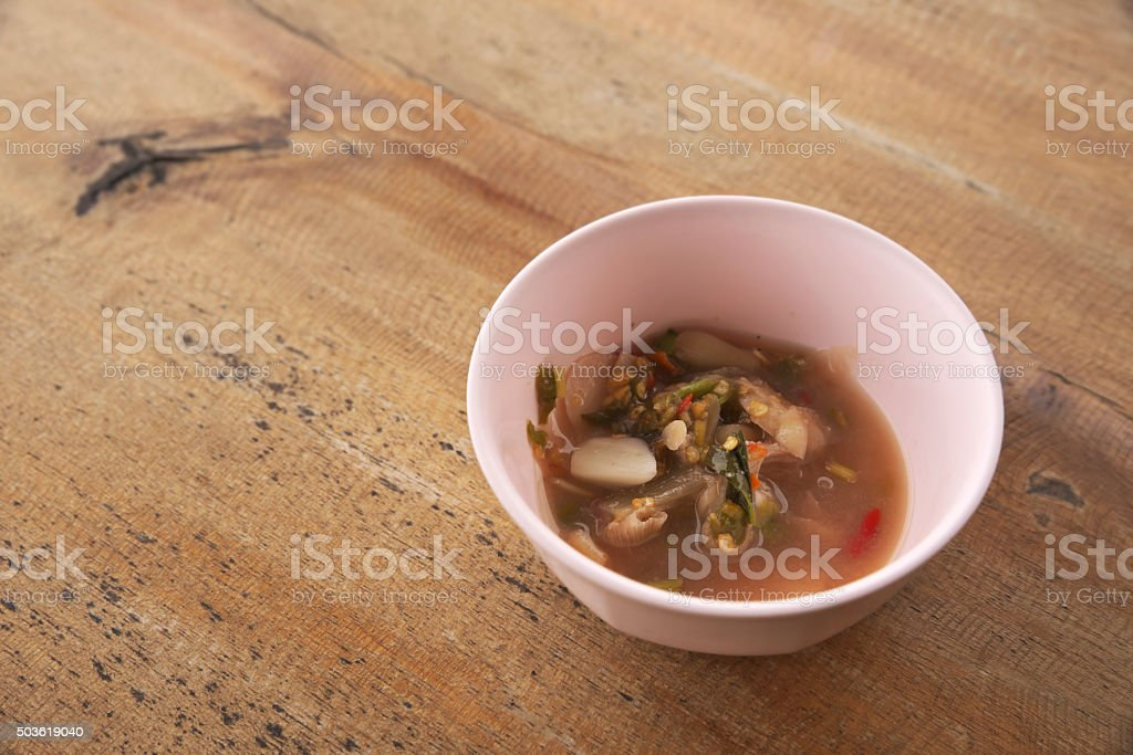 Left over food in pink bowl stock photo