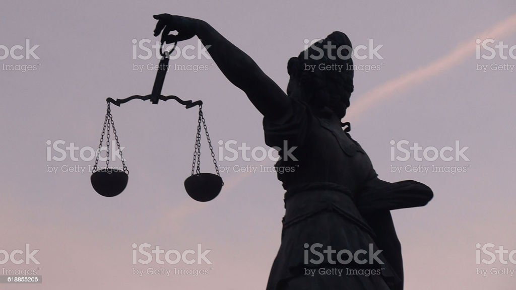 Left Side Hand Of Lady Justice Holding Weight Scale stock photo