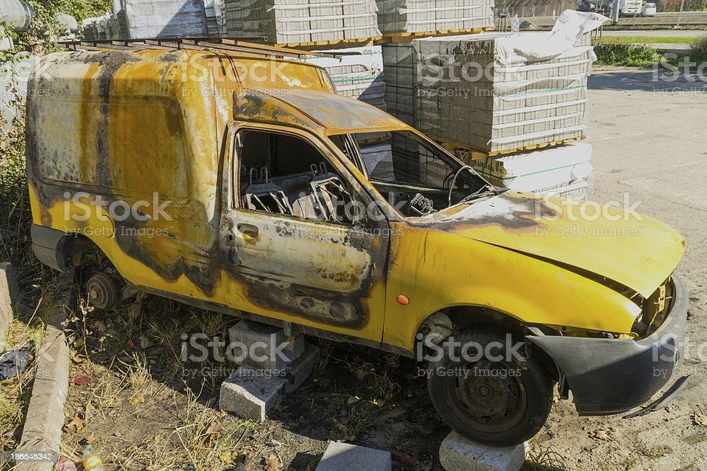 Left to burned car after theft royalty-free stock photo