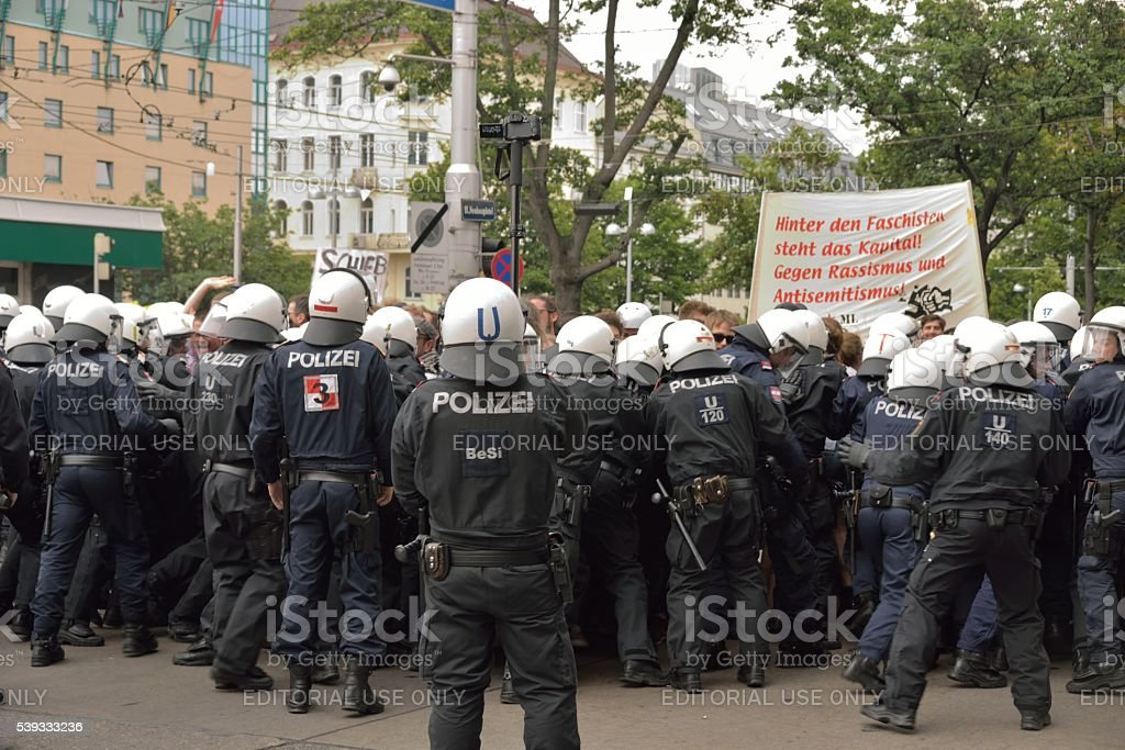 Leftist counter-demonstrators surrounded by special forces stock photo