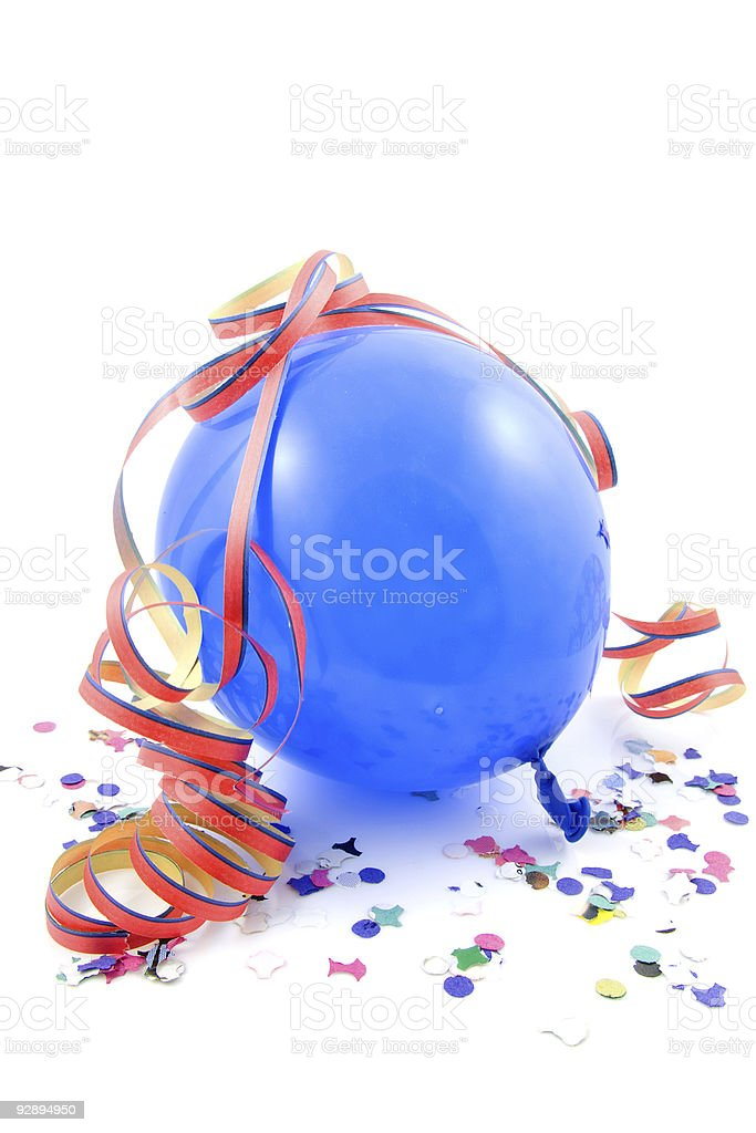A leftover blue balloon and confetti from a party stock photo