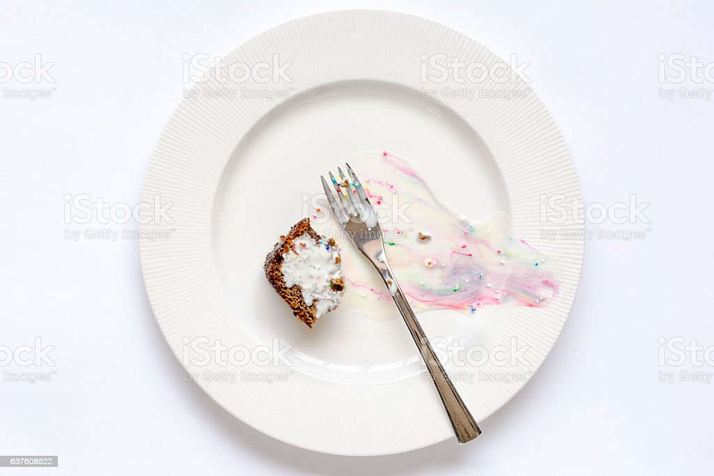 Leftover cake and melted ice cream. stock photo