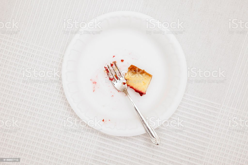 Leftover in plastic plate on white tablecloth stock photo