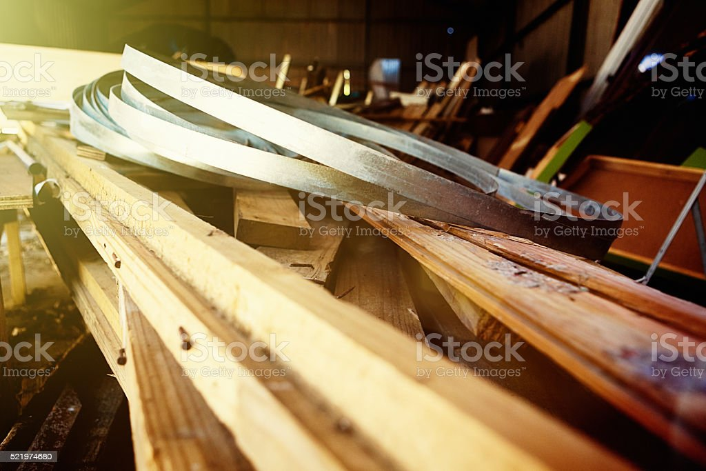 Leftover junked building materials stacked in barn stock photo