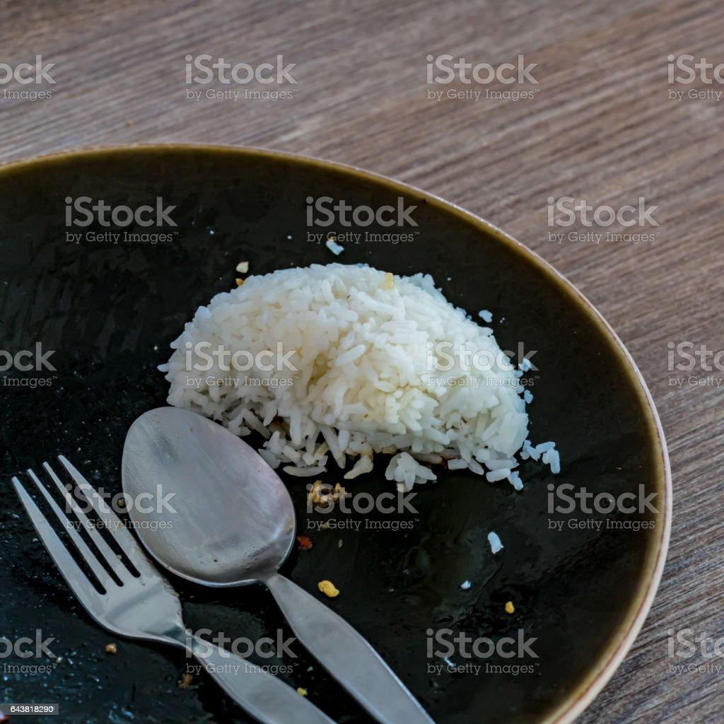 Leftover rice on dish stock photo