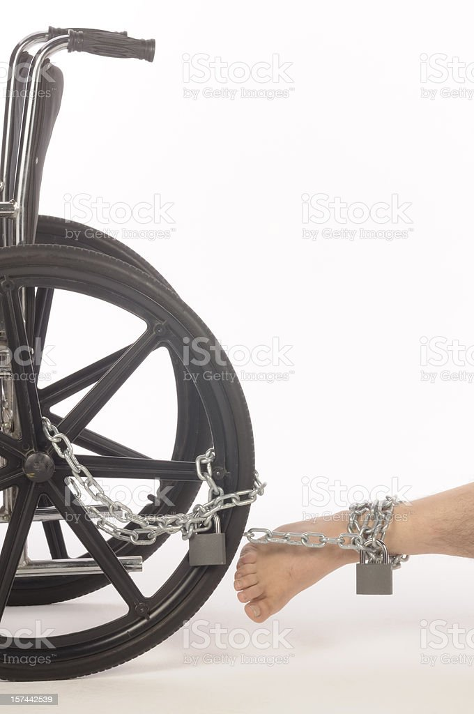 Leg Chained to Wheelchair royalty-free stock photo