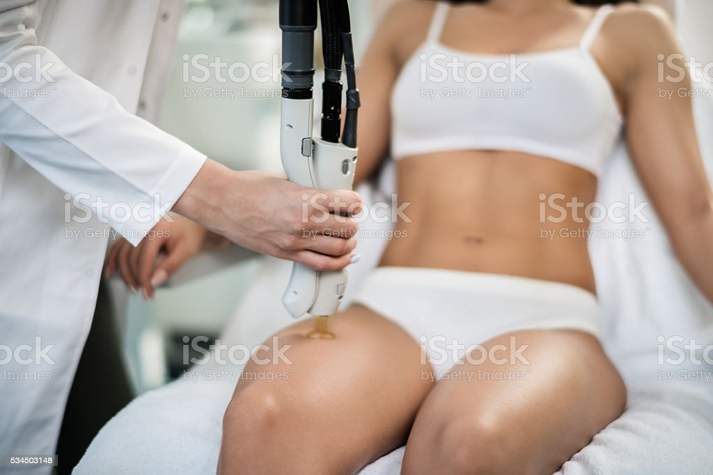 Leg epilation treatment stock photo