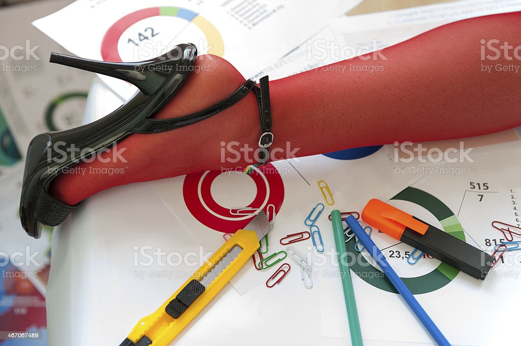Leg in Red Stocking on table with Charts royalty-free stock photo