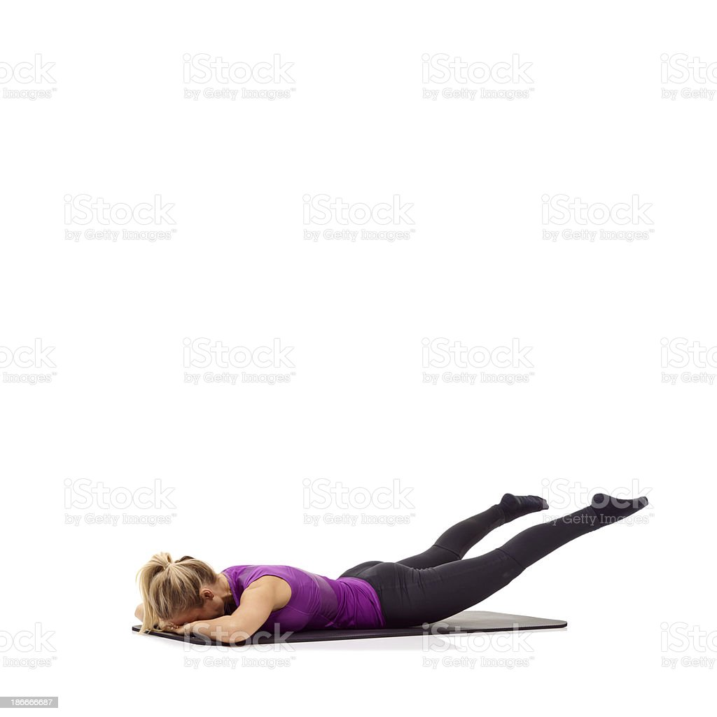 Leg lifts to strengthen the glutes royalty-free stock photo