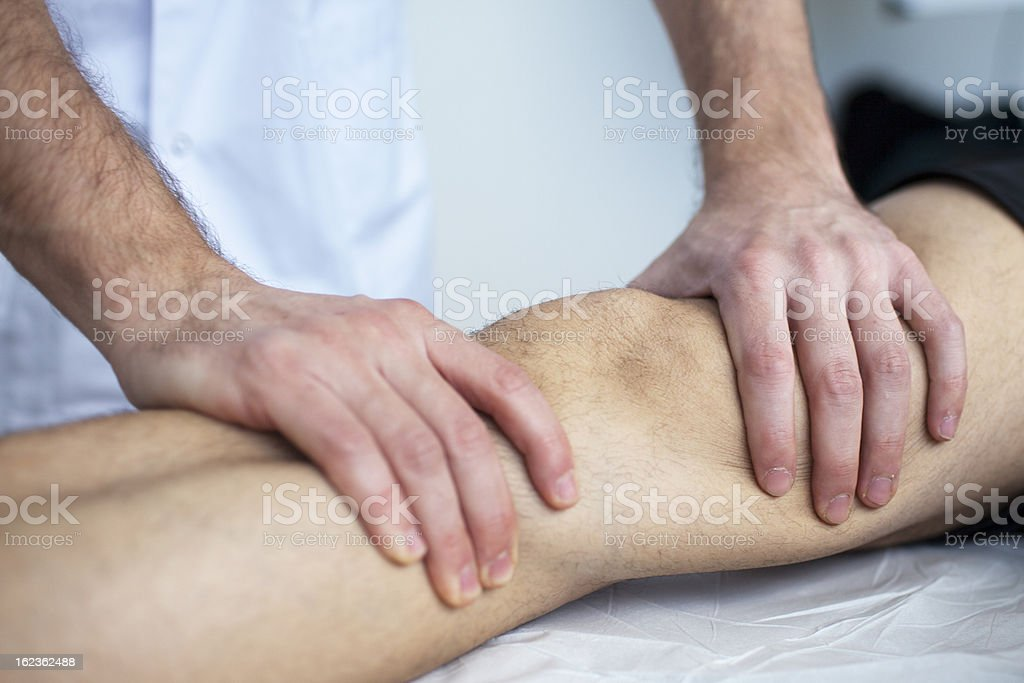 Leg massage stock photo