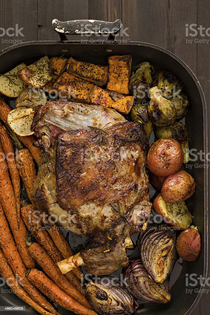 Leg Of Lamb And Roasted Vegetables stock photo