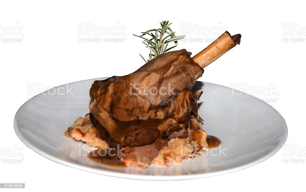leg of lamb on white plate stock photo
