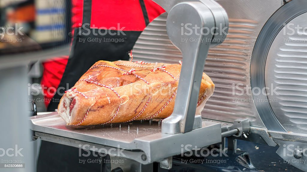 Leg Of Prosciutto Ham. Gourmet Meat Deli, Meat Slicer. stock photo