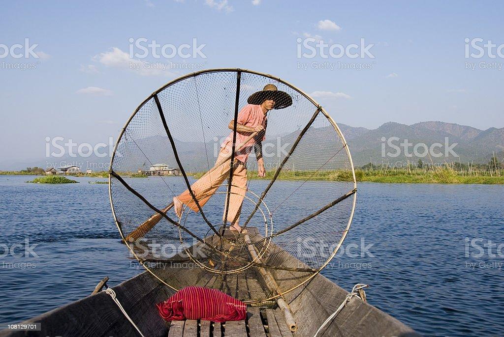 Leg rowing fisherman at Inle Lake, Myanmar stock photo