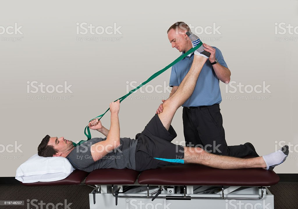 Leg Stretch With Strap in Physical Therapy stock photo