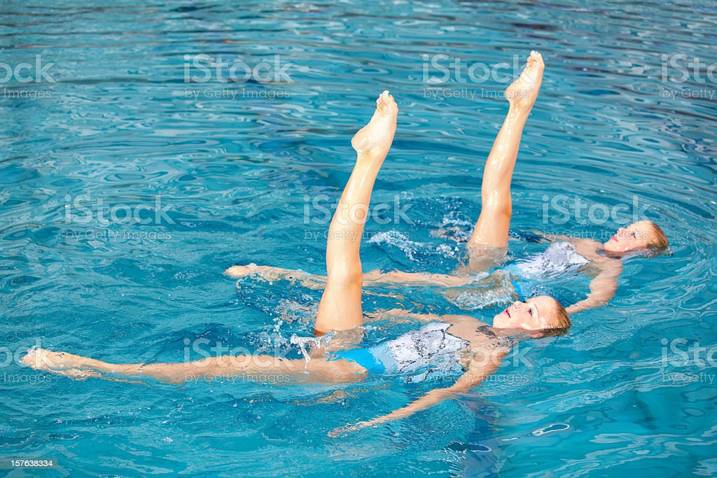 leg symmetry of synchronized swimming girls stock photo