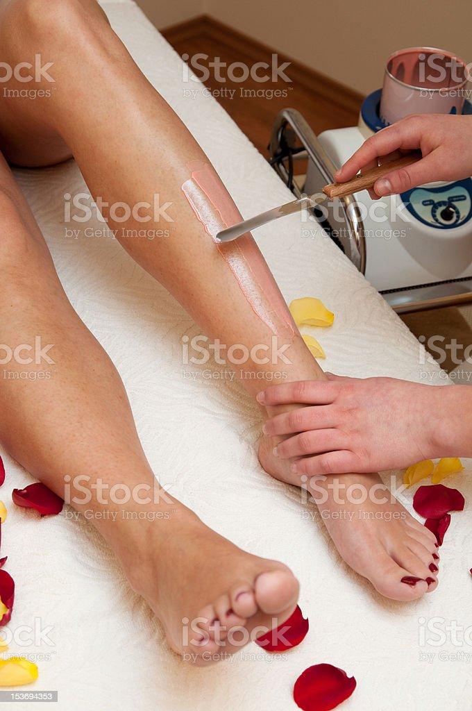 Leg waxing royalty-free stock photo