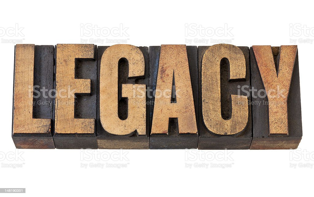 'Legacy' imprinted in vintage wooden letterpress stock photo