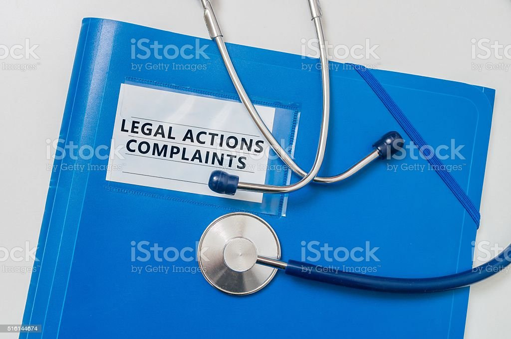 Legal Actions and Complaints in blue folder. Medical failure concept. stock photo