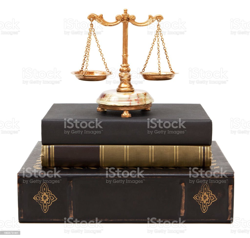 Legal books and scales of justice stock photo