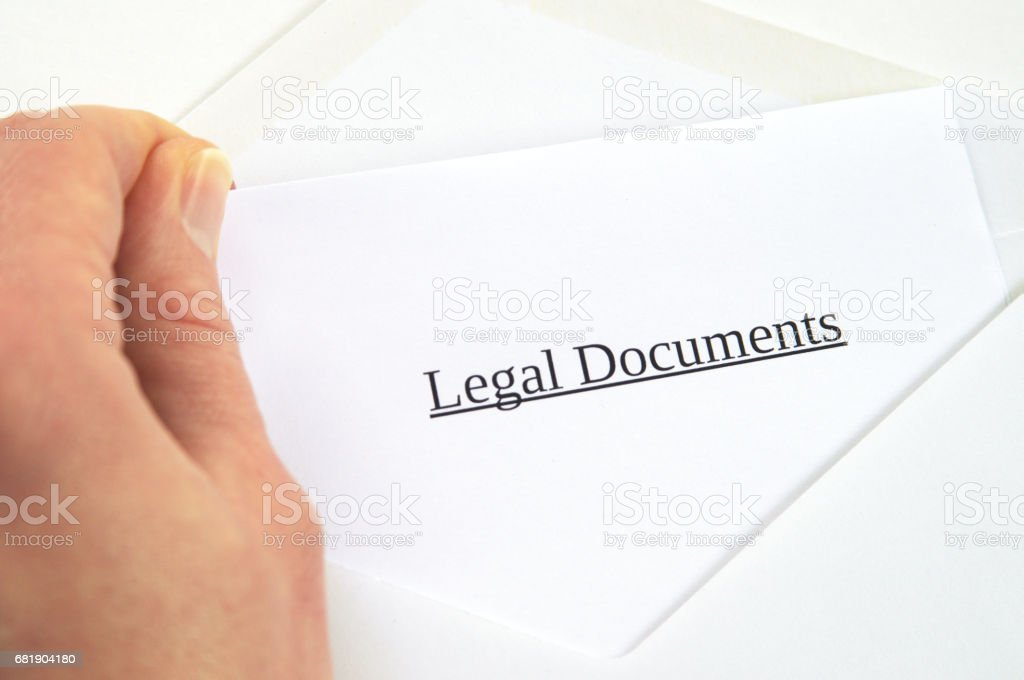 Legal Documents printed on white paper and envelope, hand holding it, white background stock photo
