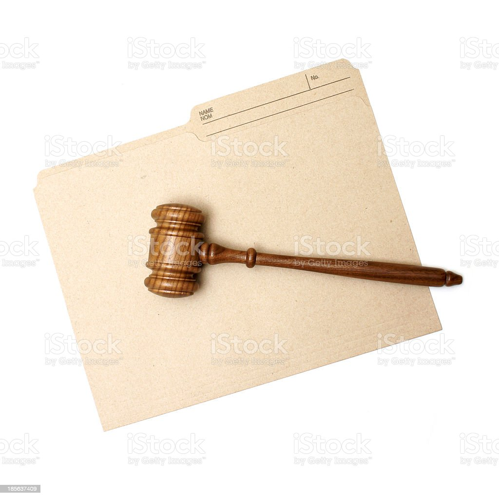 Legal folder and judge's gavel royalty-free stock photo