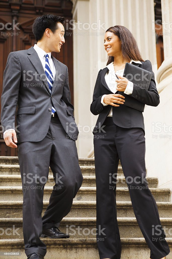 Legal or Business Professionals Walking Down Staircase stock photo