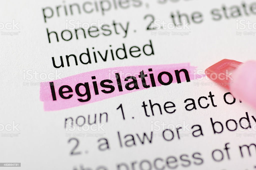 Legislation highlighted in dictionary stock photo