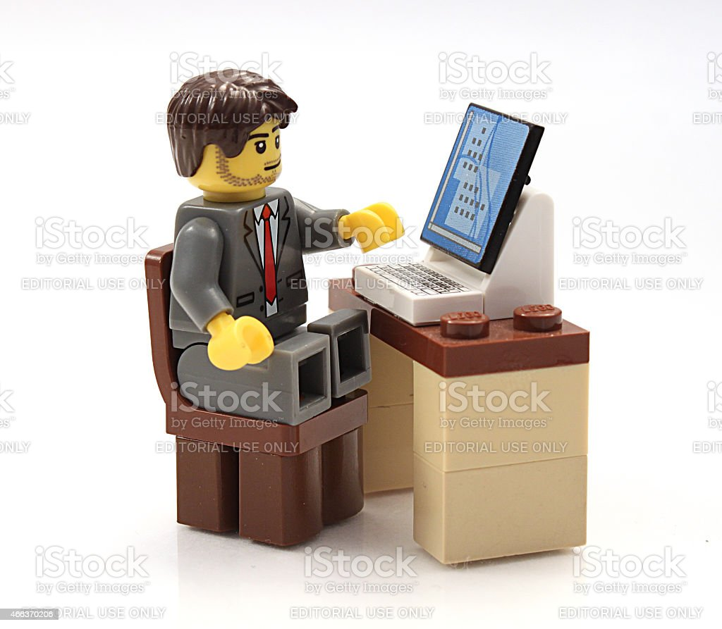 Lego Businessman at his computer stock photo