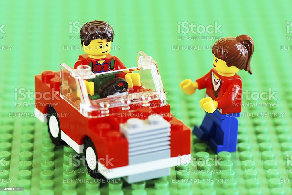 Lego couple with new car stock photo