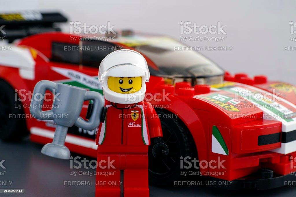 Lego Ferrari 458 Italia GT2 driver minifigure with cup stock photo