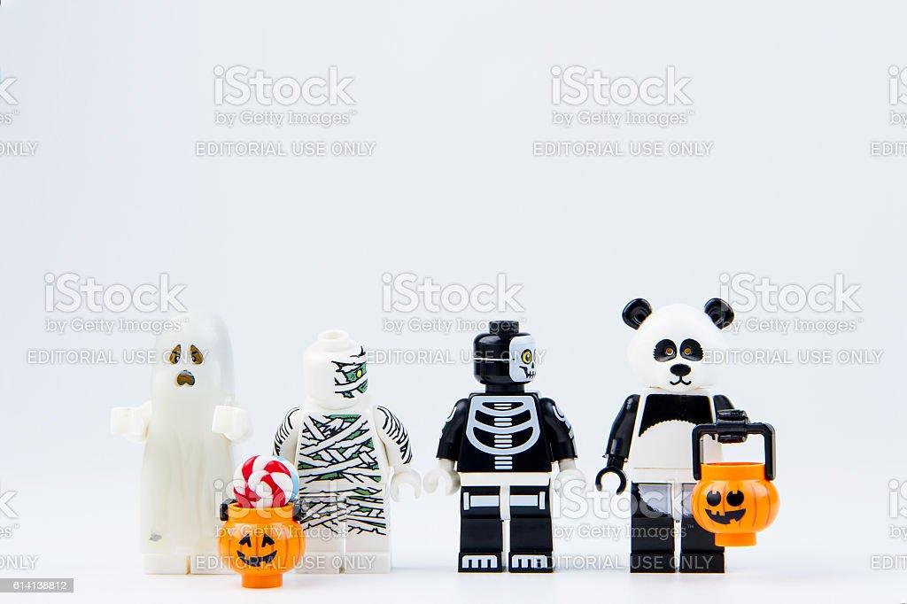 Lego ghost halloween and Lego panda want halloween candy stock photo