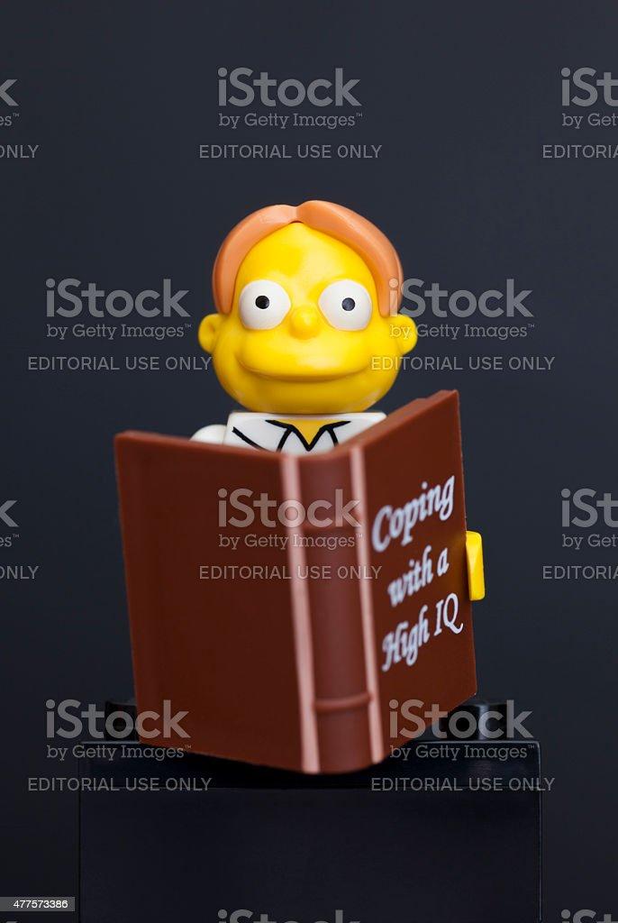 Lego Martin Prince minifigure with book stock photo