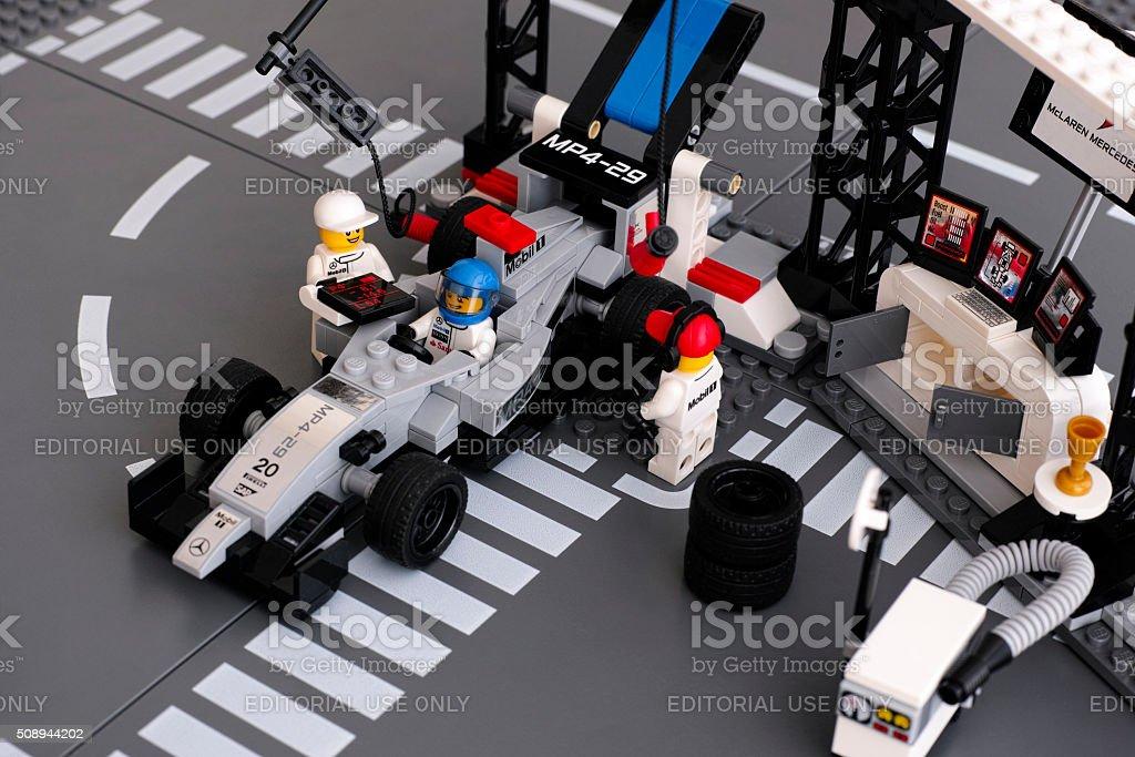 Lego MP4-29 race car in McLaren Mercedes Pit Stop stock photo