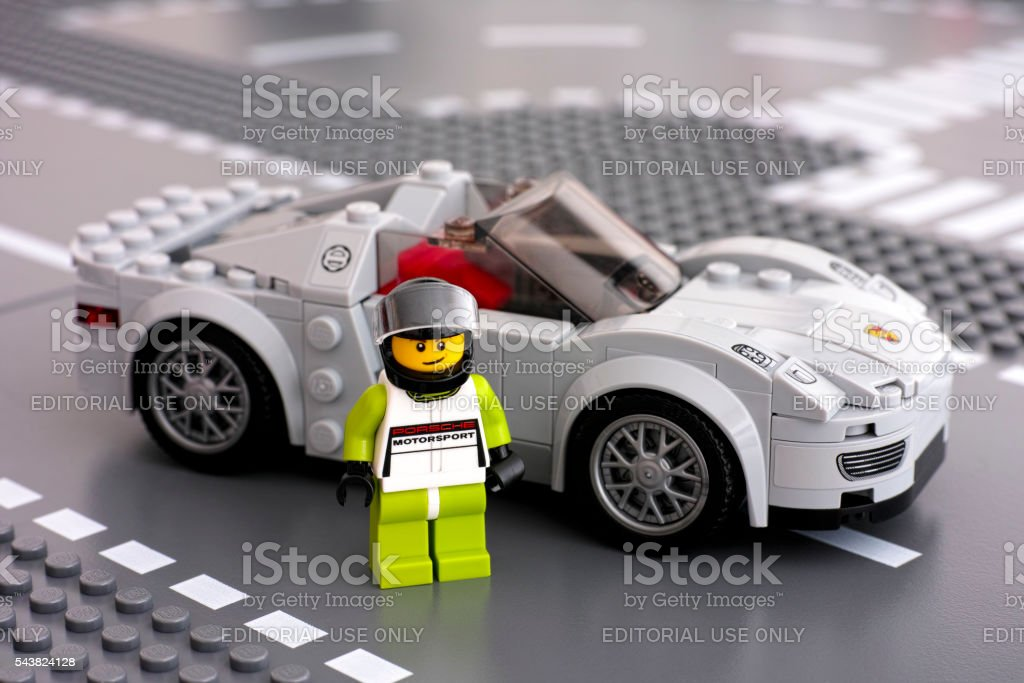 Lego Porsche driver minifigure and his car by LEGO Speed Champions stock photo