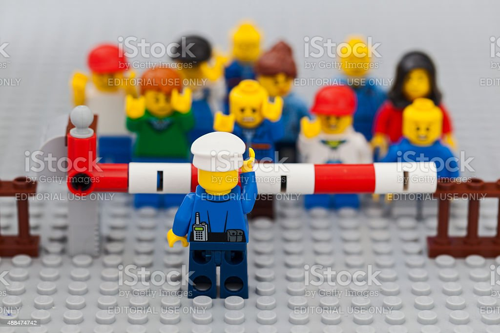 Lego refugees stopped by police at border. Syrian crises. stock photo
