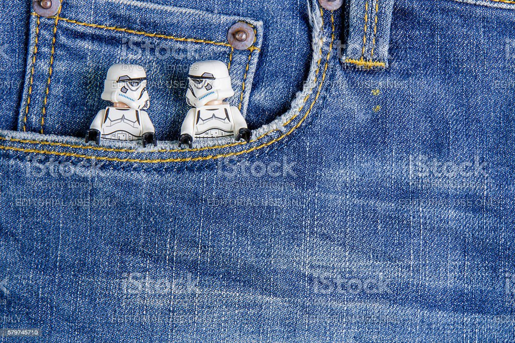 Lego star Climbing up into the pocket jeans. stock photo