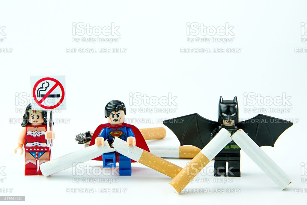 Lego Superman VS Batman destroying cigarette stock photo