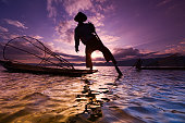 Leg-rowing fisherman on Inle Lake during sunset, Myanmar