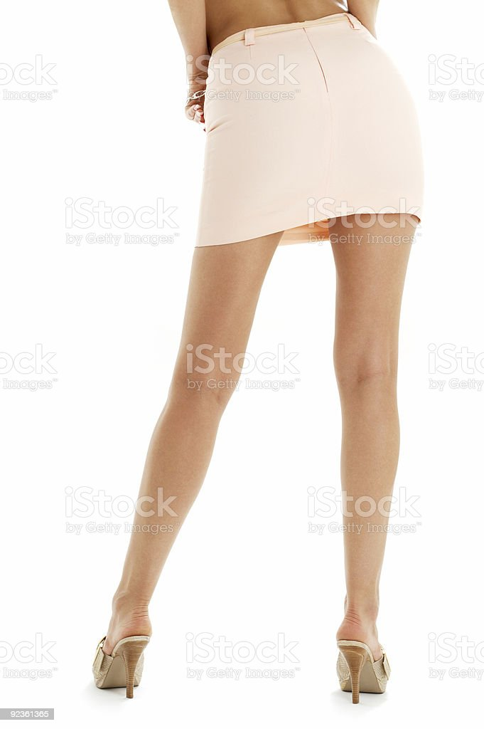 legs and back of lady in pink skirt royalty-free stock photo