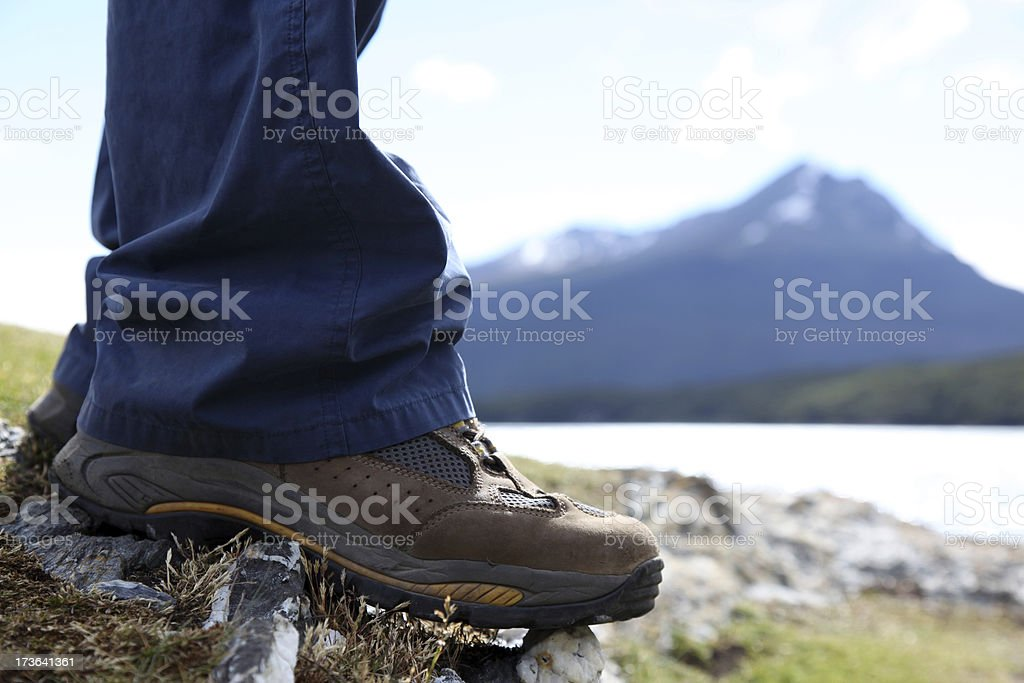 Legs and Hiking Boots on Mountain Summit royalty-free stock photo